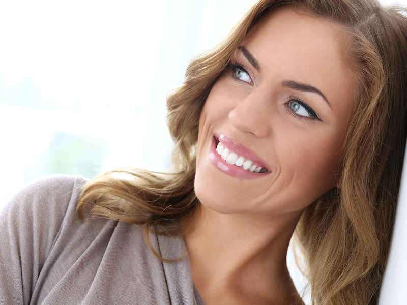 Attractive, beautiful woman with wide smile